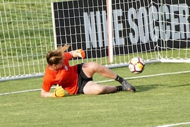 A goal keeper letting a goal in