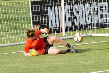 A goal keeper letting a goal in